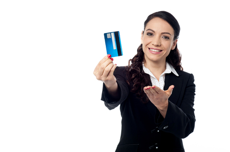 Corporate executive showing her debit card Stock Photo