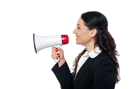 making an announcement: Corporate woman making announcement with loudhailer Stock Photo