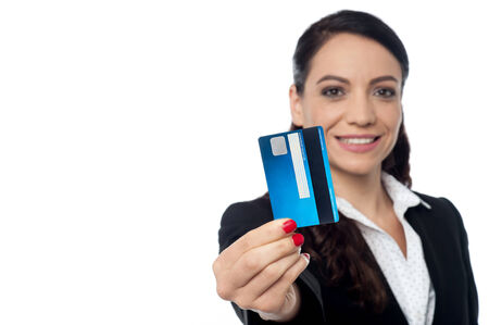 debit card: Young female executive showing debit card