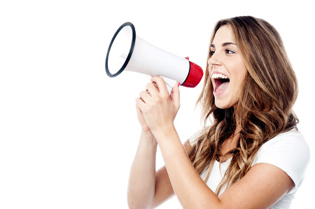 making an announcement: Woman making announcement with megaphone