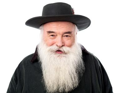 Smiling old man wearing a cowboy hat photo