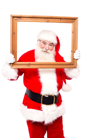saint nick: Santa claus looking through empty picture frame