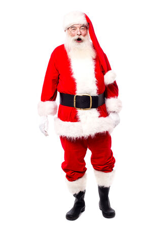saint nick: Santa claus standing isolated over white Stock Photo