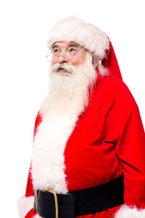 saint nick: Santa claus looking away. Isolated on white.