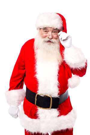 saint nick: Father christmas looking into the camera Stock Photo