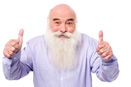 posing  agree: Mature man showing thumbs up gesture