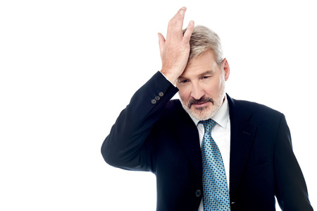 duh: Businessman slapping hand on head, realizes mistake.