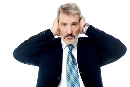 hands covering ears: Senior businessman covering his ears with hands Stock Photo