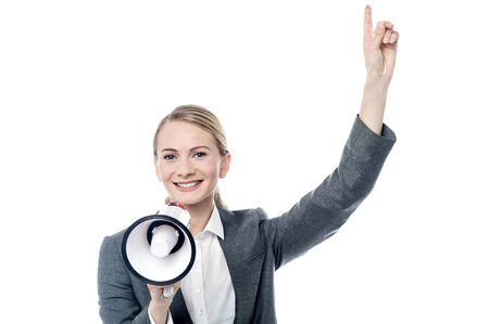 mega phone: Business woman with mega phone and pointing up Stock Photo