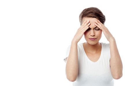 Frustrated woman holding her head, painful.