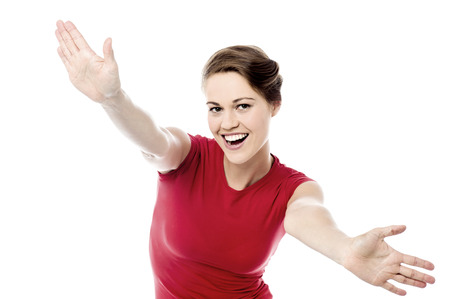 wide open: Cheerful woman with her arms wide open