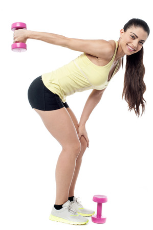 posing  agree: Fitness woman working out with dumbbells