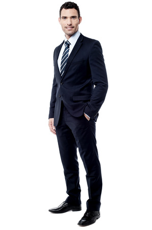 Full length of businessman with hand in pocket Standard-Bild