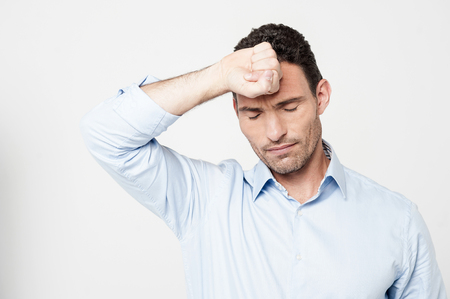 bothered: Disappointed man bothered by mistakes Stock Photo