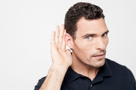hearsay: Handsome man paying attention to gossip Stock Photo