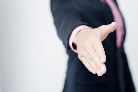 hands giving: Cropped image of businessman extending hand to shake