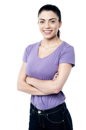 Confident woman posing with crossed arms
