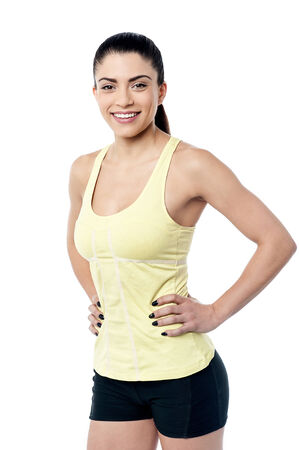 Beautiful smiling woman with hands on waist