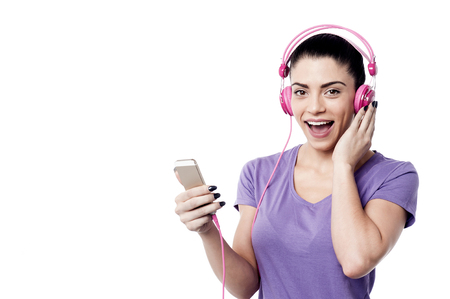 copy sapce: Attractive woman enjoying music from her cell phone