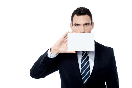 Businessman cover his face with blank card photo