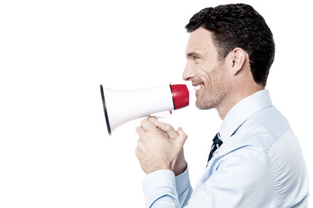 making an announcement: Corporate man making announcement with loudhailer Stock Photo