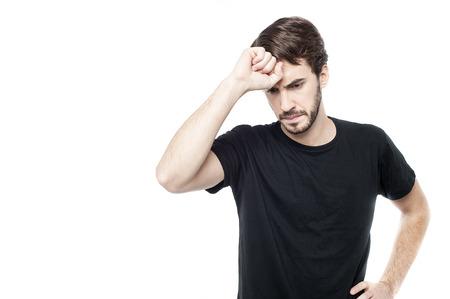 Worried man tries to remember something