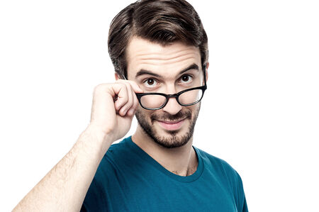 Man adjusting his glasses to get a better view Stock Photo