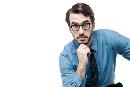 deeply: Businessman thinking deeply with hand on chin