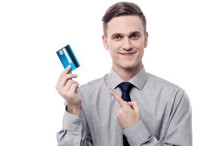 debit card: Young businessman displaying his debit card