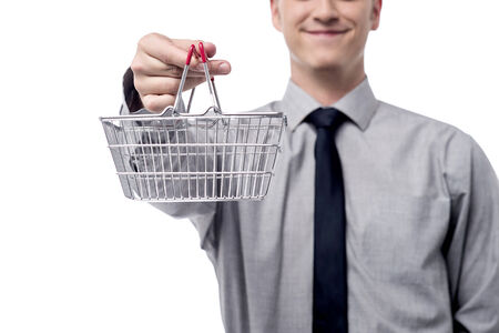 young add: Cropped image of executive holding shopping cart