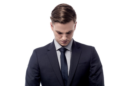 head down: Worried businessman bending head down Stock Photo
