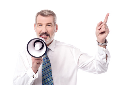 loudhailer: Business executive with loudhailer and pointing up Stock Photo