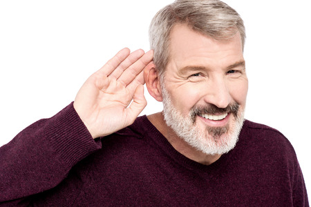 perceive: Mature man cupping hand behind ear Stock Photo
