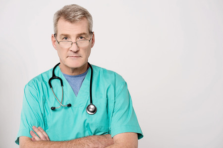 Confident male doctor posing with crossed arms photo