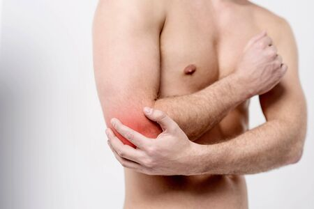 contusion: Male having pain in an elbow joint