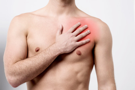 heartbreak issues: Male suffering pain on his chest muscle Stock Photo
