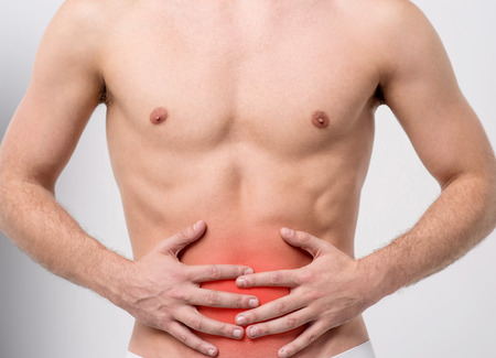 reddening: Muscular man with stomach pain