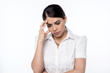depressed woman: Depressed woman touching her forehead Stock Photo