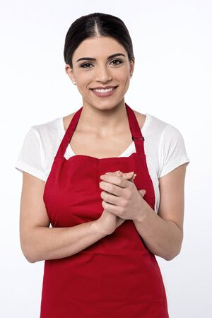 chef uniform: Female chef posing with her hands clasped