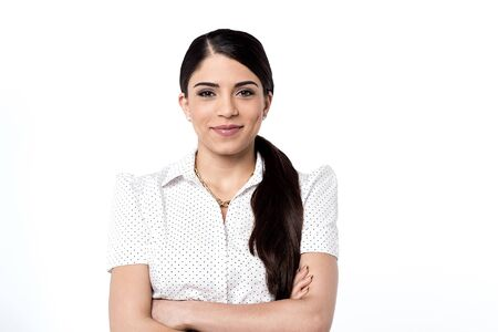 Confident young woman posing casually to camera Stock Photo