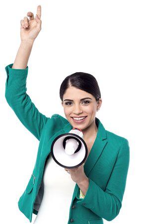 loudhailer: Charming woman make advertising with loudhailer