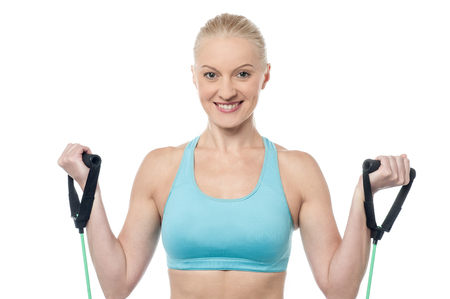 resistance: Woman instructor exercising with a resistance band Stock Photo