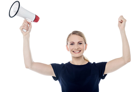 loudhailer: Cheering woman with fists clenched and loudhailer