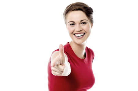 finer: Cheerful woman pointing her finer to you
