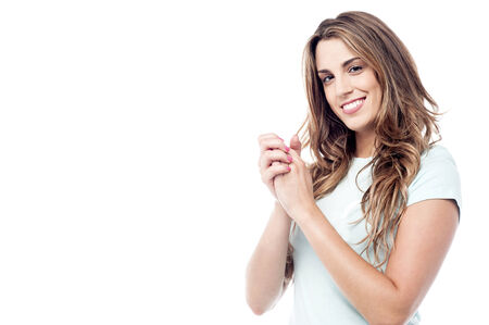 clasped hands: Young attractive woman posing with clasped hands