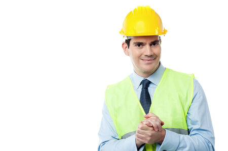clasped: Confident engineer holding his hands clasped