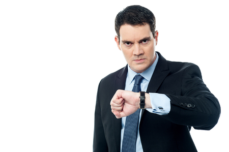 Angry businessman looking at his wristwatch