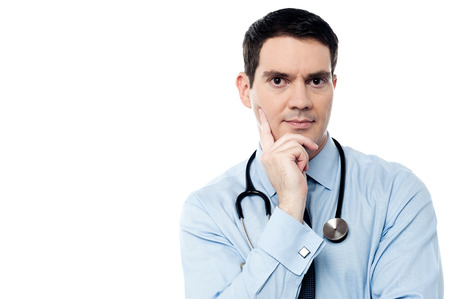 chin: Deep thinking male doctor with hand on chin