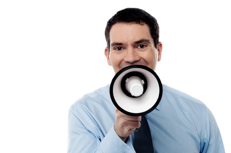 making an announcement: Corporate man making announcement over loudhailer Stock Photo
