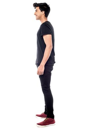full length: Full length of young smiling teen standing